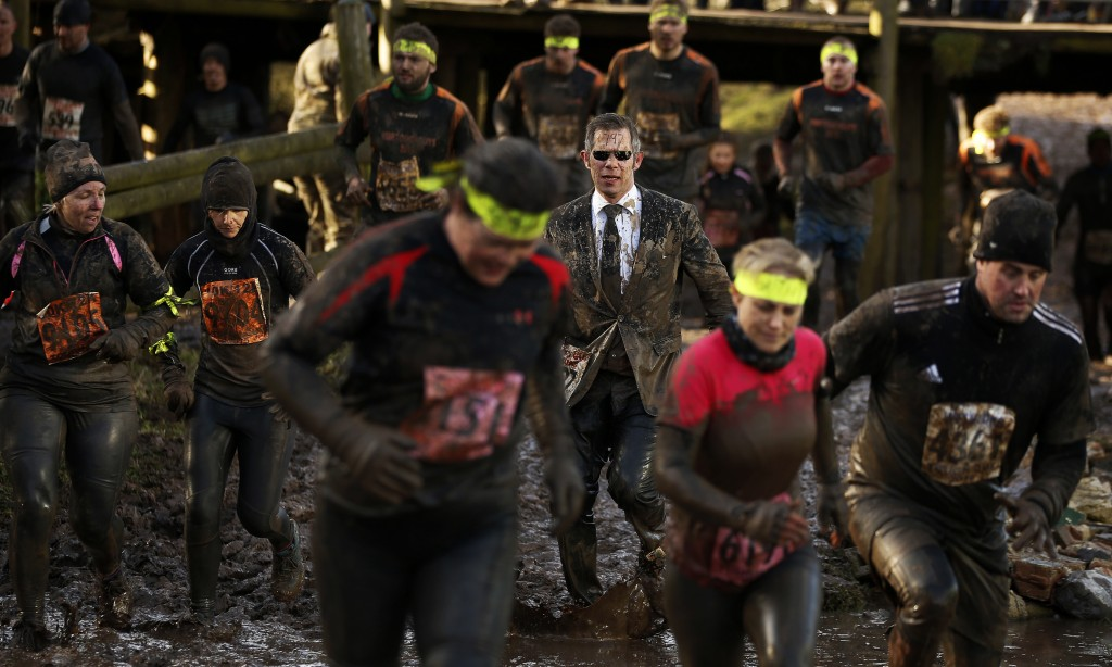 competitors run through mud during the Tough Guy event in Perton, central England February 1, 2015, SPORT SOCCER TPX IMAGES OF THE DAY