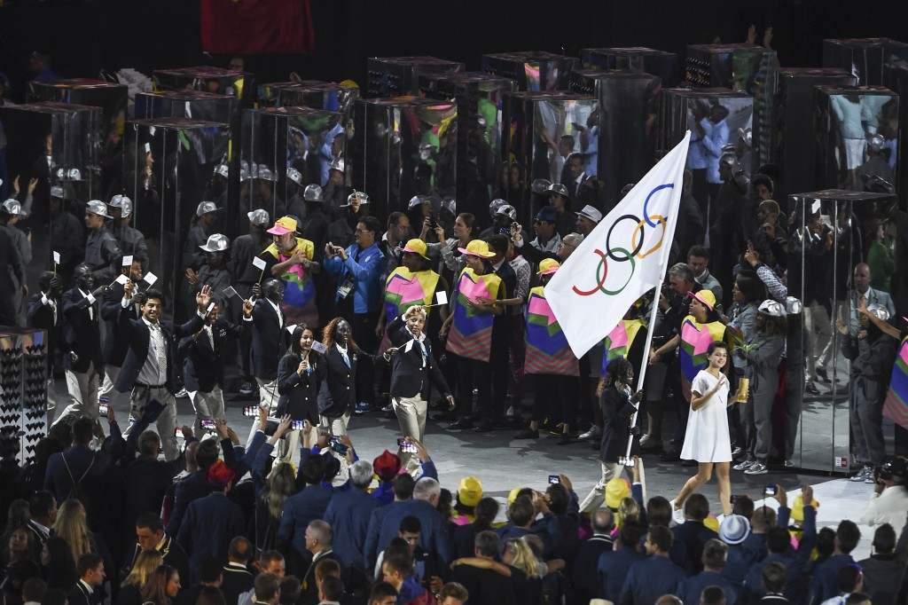 Rose carrying the flag and all the Refugee Team entering Maracana during the opening ceremony