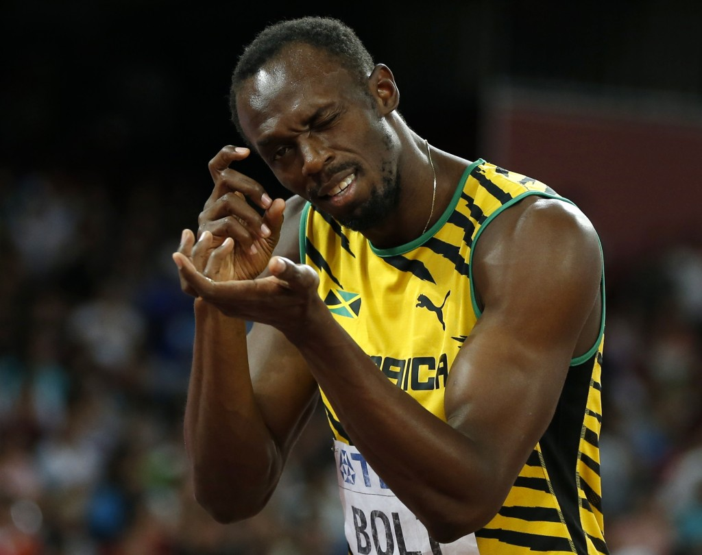 Usain Bolt Jamaica gestures towards the photographers before his men's 200 metres heat at the 15th IAAF World Championships at the National Stadium in Beijing China
