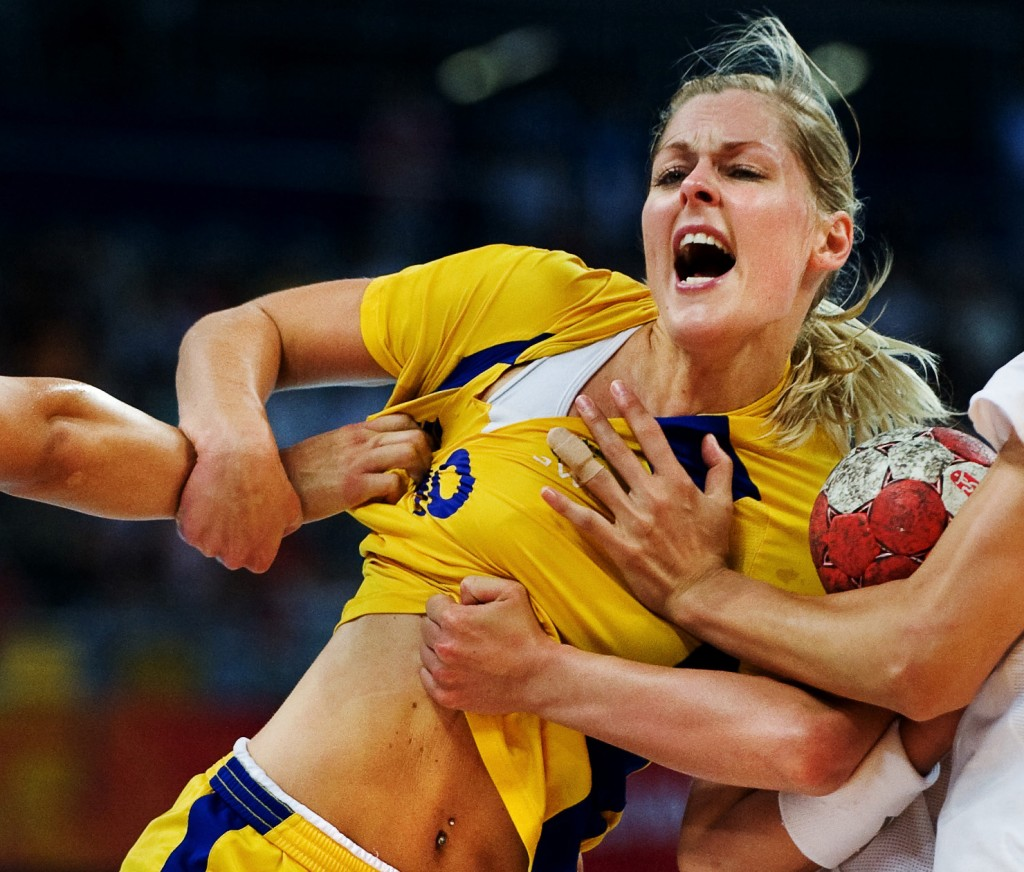 Teresa Utkovic of Sweden is brutally stopped by the Chinese players in the Olympic Games' handball game between Sweden and China on August 21, 2008.