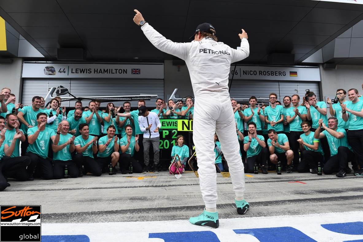 Austrian Grand Prix winner Nico Rosberg cheers with his team