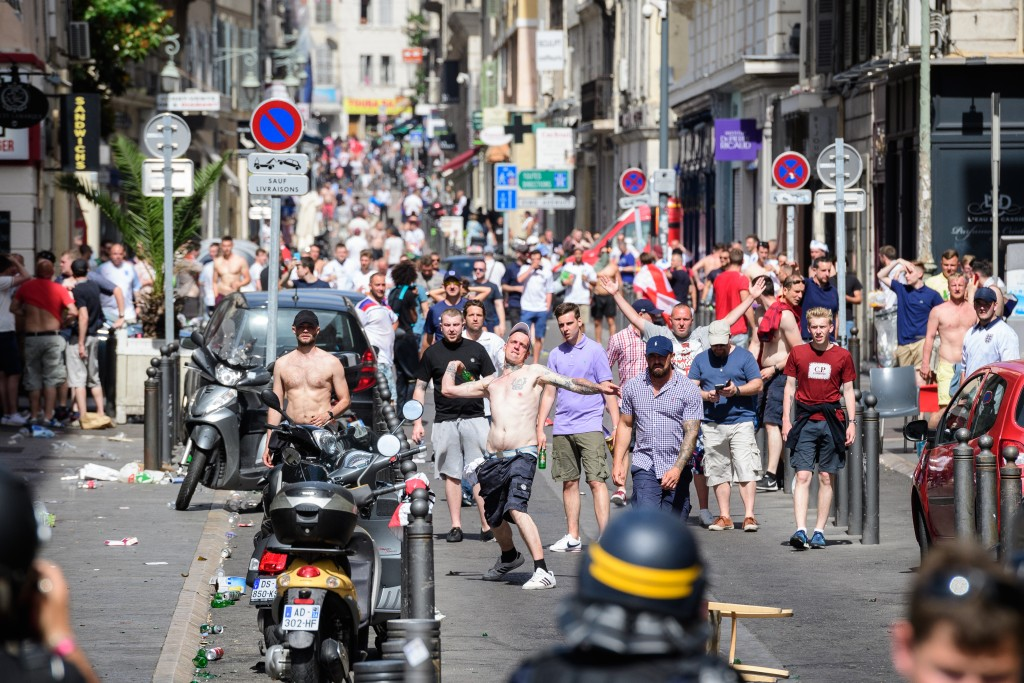 local gangs, French riot squads, throwing bottles, streets, France, EURO, football