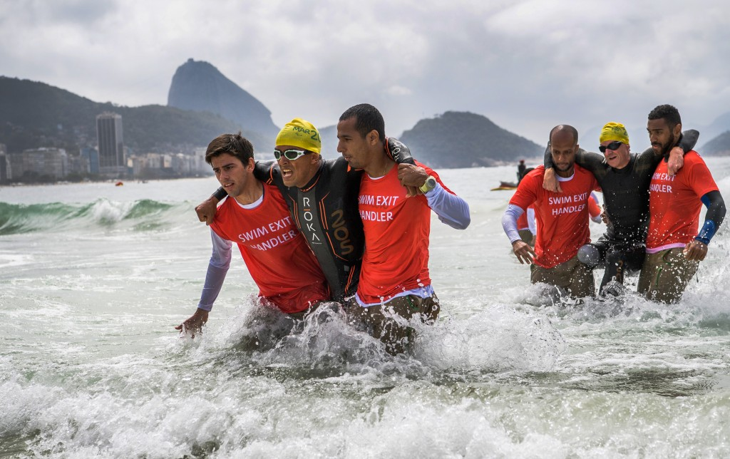 Paralympic, Mohamed Lahna MAR (left) and Stephane Bahier FRA are aided out of the water during the Men's PT2 Triathlon competition at Fort Copacabana. The Paralympic Games, Rio de Janeiro, Brazil,