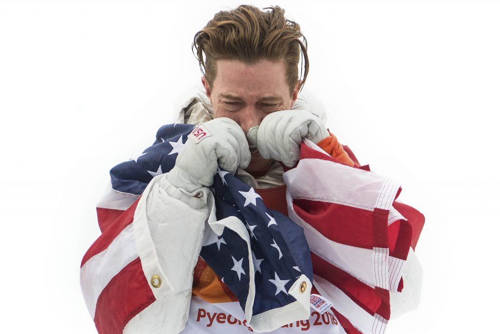 Gold medalist Shaun White of the United States shows his emotion during the victory ceremony for the Snowboard Men's Halfpipe Final on day five of the Pyeongchang 2018 Winter Olympics at Phoenix Snow Park on February 14, 2018 in Pyeongchang-gun, South Korea. Nikon D5 | AF-S NIKKOR 24-70mm f/2.8E ED VR @58mm | 1/2500s | F3.5 Photo by David Ramos/Getty Images