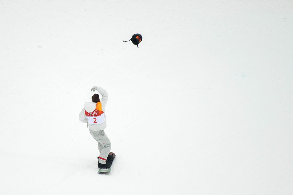 Gold medalist Shaun White of the United States throws his helmet as he celebrates after his first round during Snowboard Men's Halfpipe Final on day five of the Pyeongchang 2018 Winter Olympics at Phoenix Snow Park on February 14, 2018 in Pyeongchang-gun, South Korea. Nikon D5 | AF-S NIKKOR 70-200mm f/2.8E FL ED VR @200mm | 1/2000s | F2.8 Photo by David Ramos/Getty Images