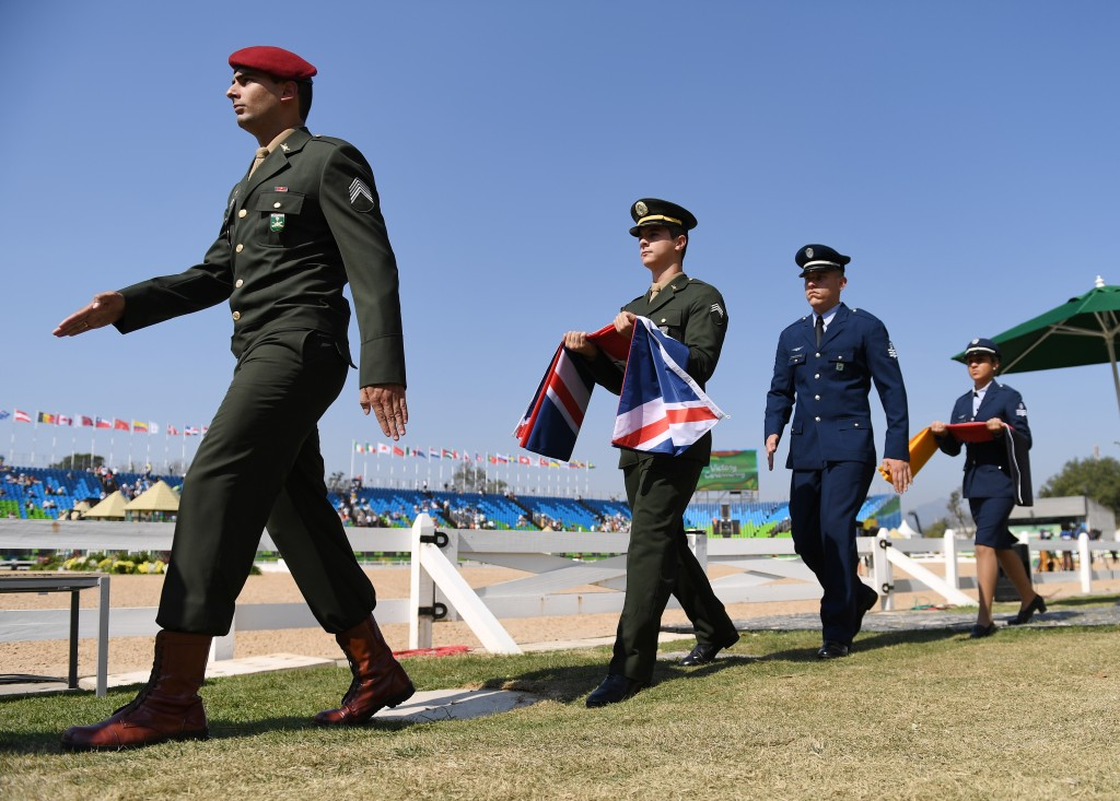 Officers bringing the flags for the victory ceremony at Deodoro equestrian Stadium. The british flag is for gold medal winner Charlotte Dujardin (Great Britain) and her horse Valegro for her individual freestyle dressage Grand prix performance in the equestrian stadium of Deodoro