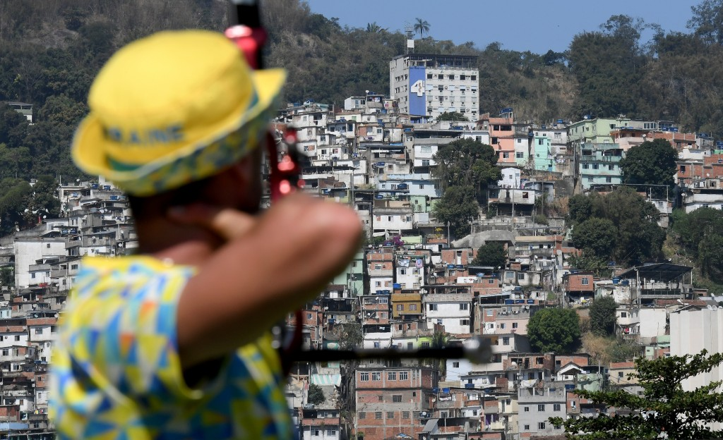 RIO DE JANEIRO, BRAZIL - AUGUST 02: An athlete seen in front of the favela Morro da Mineira during a training session at the Sambodromo Olympic Archery venue on August 2, 2016 in Rio de Janeiro, Brazil. (Photo by Matthias Hangst/Getty Images)