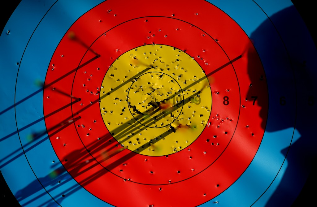 RIO DE JANEIRO, BRAZIL - AUGUST 02: An athlete looks on his arrows in the target during a training session at the Sambodromo Olympic Archery venue on August 2, 2016 in Rio de Janeiro, Brazil. (Photo by Matthias Hangst/Getty Images)