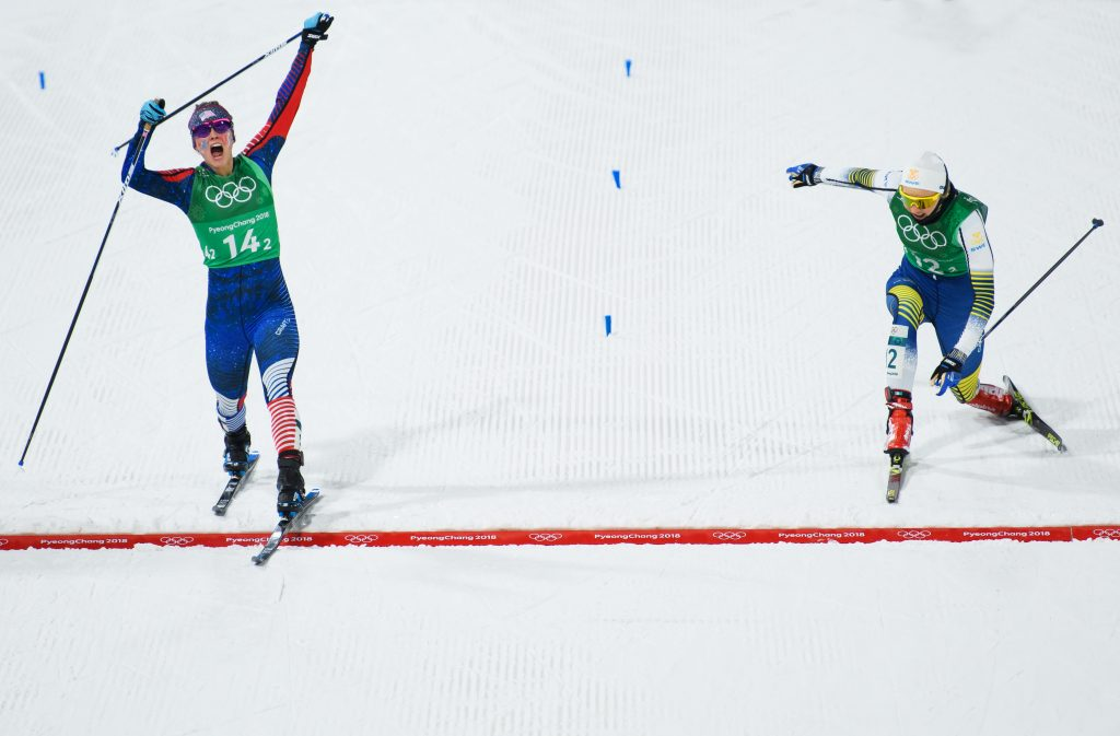 Jessica Diggins of the United States (14-2) stretches across the finish line to win gold ahead of Stina Nilsson of Sweden (12-2) during the Cross Country Ladies' Team Sprint Free Final on day 12 of the PyeongChang 2018 Winter Olympic Games at Alpensia Cross-Country Centre on February 21, 2018 in Pyeongchang-gun, South Korea. Nikon D5 | AF-S NIKKOR 70-200mm f/2.8E FL ED VR + AF-S Teleconverter TC-14E III | ISO 2500 | 1/1600s | f/4.5 Photo by Matthias Hangst/Getty Images