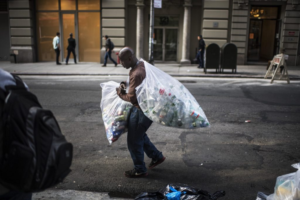 A man in New York collecting plastic bottles from the street to sell on to make a living - captured by Nikon European Ambassador, Kadir van Lohuizen