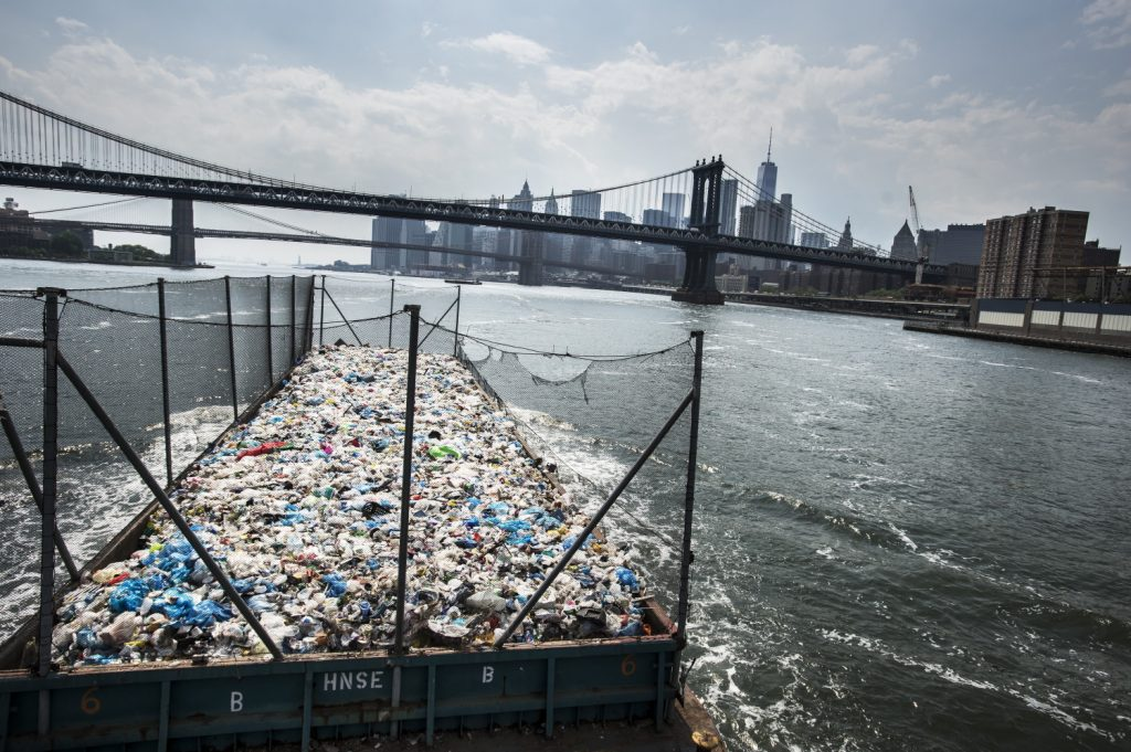 Waste being shipped out of New York city, captured by Nikon European Ambassador, Plastic waste being collected and shipped out of New York city to its neighbouring states – captured on Nikon Df + AF-S Zoom-NIKKOR 17-35mm f/2.8D IF-ED | 1/2500 sec. f/5.6 22 mm | ISO 160 © Kadir van Lohuizen