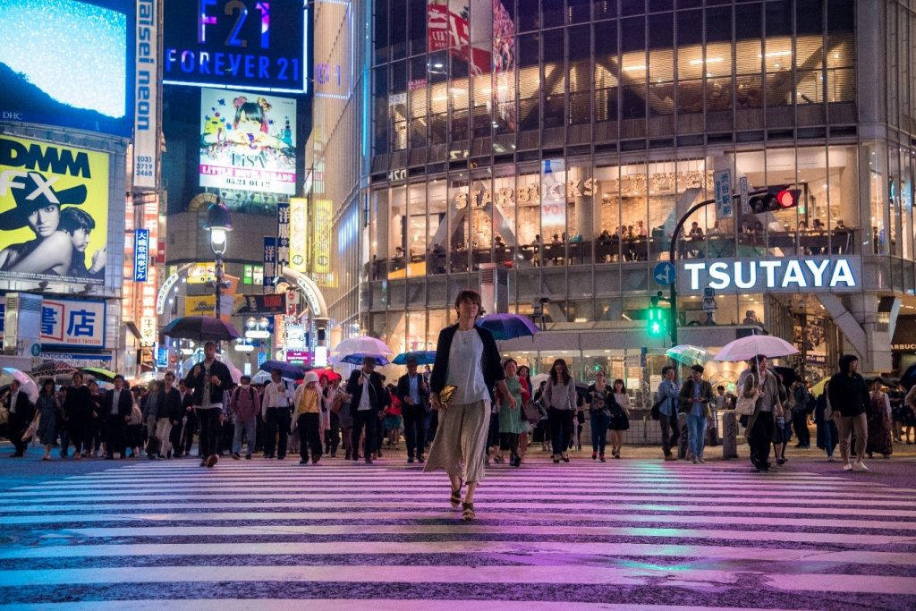 One subject stands apart from the rest at the busy Shibuya Crossing in Toyko, a solo figure in the midst of chaos. Photographed by Lukasz Palka.