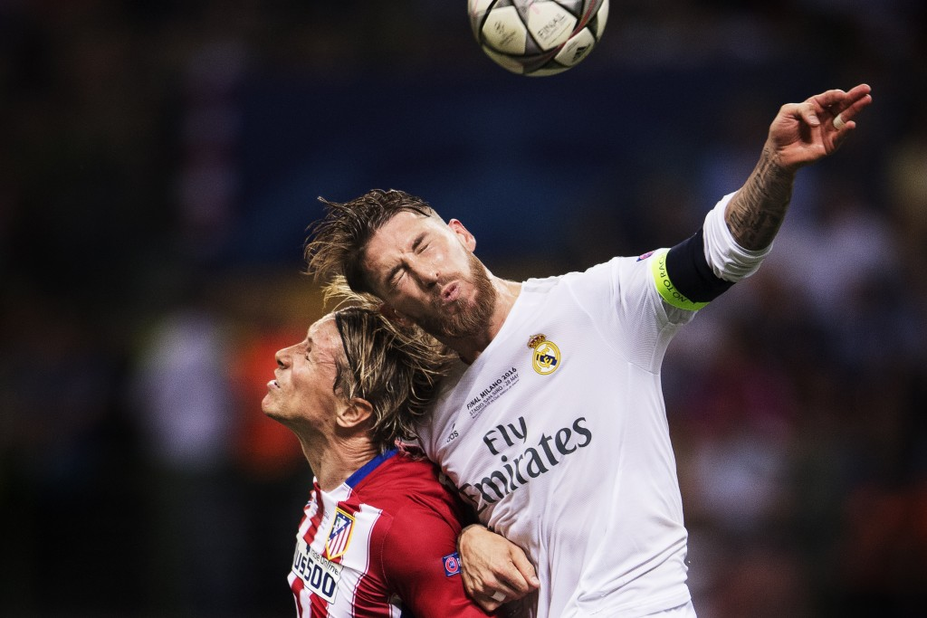 Atletico Madrid's Fernando Torres header duel with Real Madrid's Sergio Ramos during the Champions League final between Real Madrid and Atletico, Madrid May 28, 2016 in Milan. Nikon D5 + NIKKOR 400.0 mm f/2.8 @ f/2.8   400 mm   1/2000s   ISO 2500 © Joel Marklund