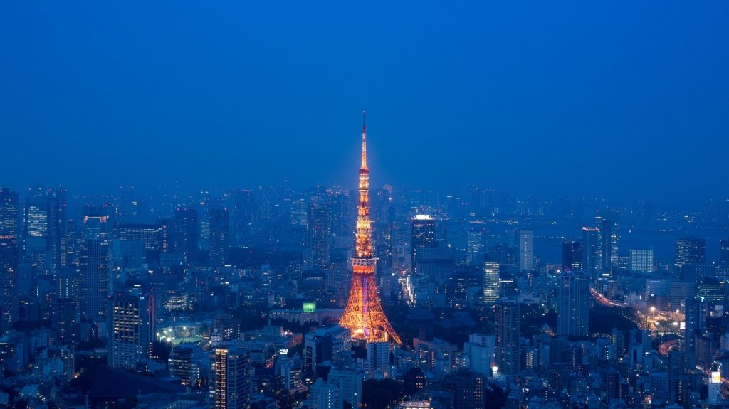 The Tokyo Tower, enveloped in an atmospheric blue haze. Photographed by Lukasz Palka.