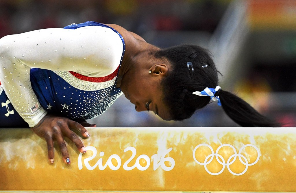 Aug 11, 2016; Rio de Janeiro, Brazil; Simone Biles, of the USA begins her performance on the beam during the women's individual all-around final in the Rio 2016 Summer Olympic Games at Rio Olympic Arena. Mandatory Credit: Robert Hanashiro, USA TODAY Sports