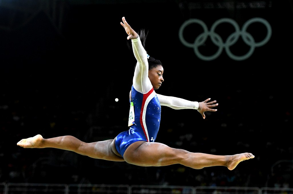 Aug 11, 2016; Rio de Janeiro, Brazil; Simone Biles of the USA hangs in the air as she competes on the beam during the women's individual all-around final in the Rio 2016 Summer Olympic Games at Rio Olympic Arena. Mandatory Credit: Robert Hanashiro, USA TODAY Sports