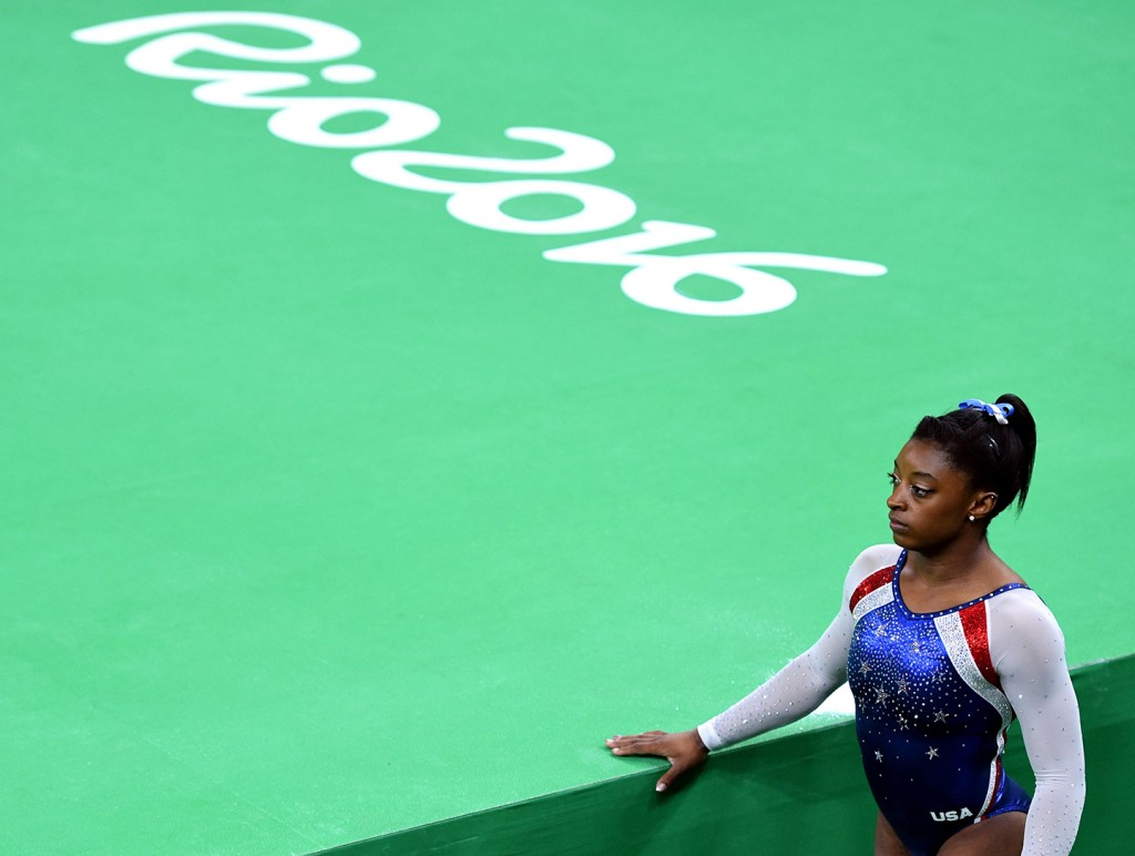 Aug 11, 2016; Rio de Janeiro, Brazil; Simone Biles of the USA waits her turn to compete on the floor, during the women's individual all-around final in the Rio 2016 Summer Olympic Games at Rio Olympic Arena. Biles was the final gymnast to compete. Mandatory Credit: Robert Hanashiro, USA TODAY Sports