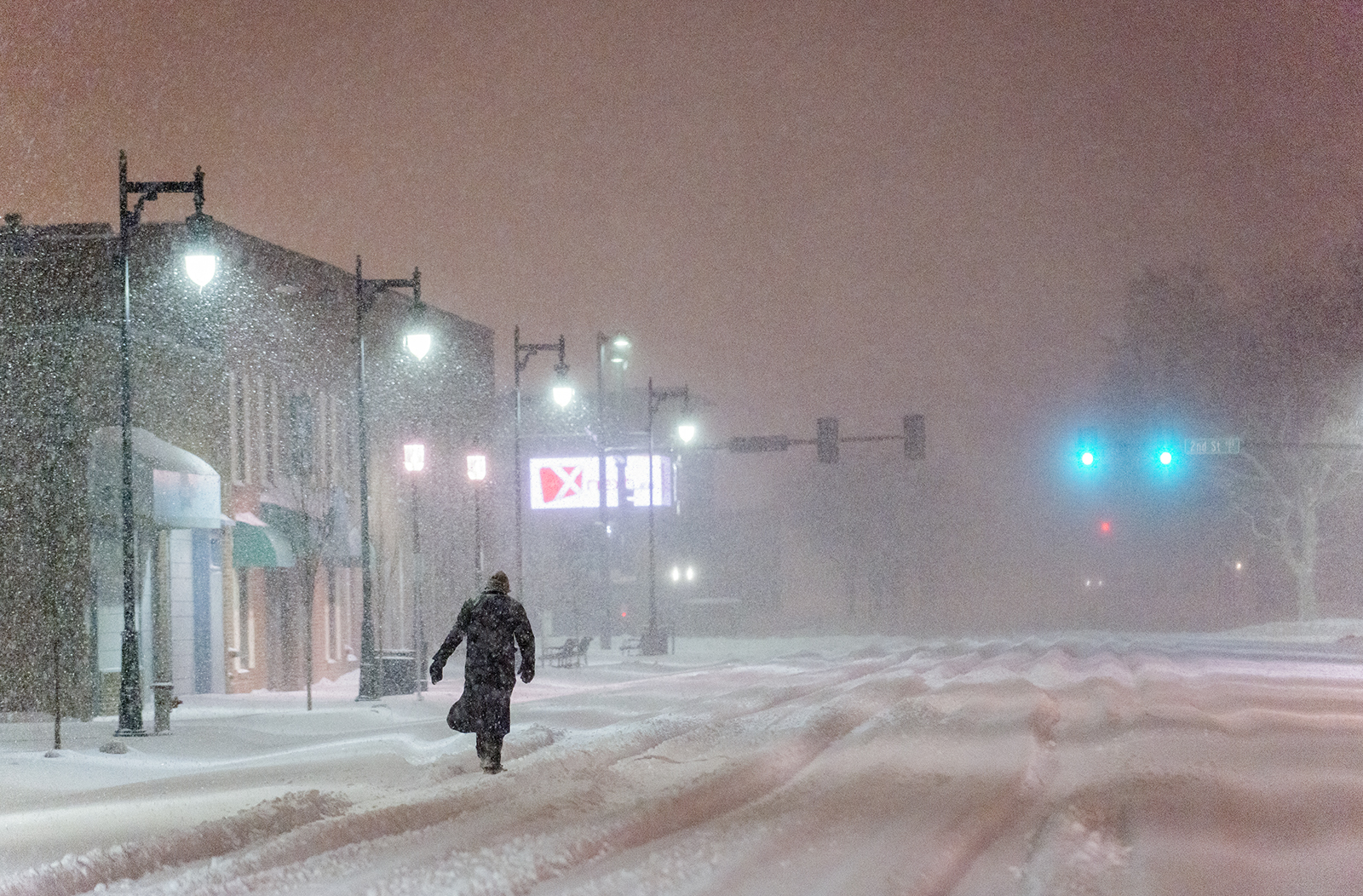 A man trudges through deep snow on his way to work during a predawn snowstorm in Wichita, Kansas on February 21, 2013.